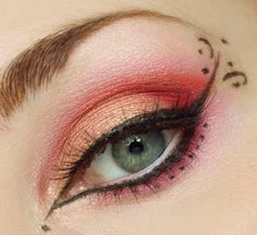Love the coral and eyeliner detail.