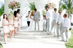 Beach wedding blush dresses / light gray suits