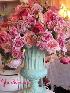 Not using a container, but rather laying flat on the altar table using all shades and sizes of pink roses!