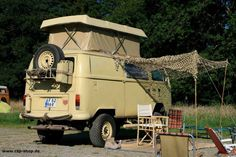 VW Westfalia camper van with awning and pop up
