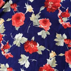 £7/m. DESCRIPTION Beautiful soft, light and drapey viscose. Royal blue background with a stunning rose print.  DETAILS: Width:               140cm Composition:   100%