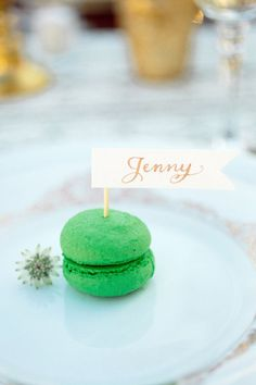 Green macaron topped by calligraphy place card created by Just Write Studios. Photography by Love by Serena / lovebyserena.com, Styling by Sarah Park Events / sarahparkevents.com, Floral Design by Floral