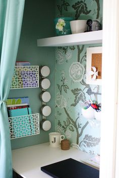 Desk in a closet space -- Organizing can be pretty! Like the colours, pockets & wallpaper.
