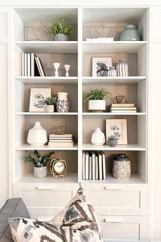 A complete design guide to bookshelf styling, style your shelf like a pro!  DIY bookshelf styling.  Make the most of your home decor, living room decor.