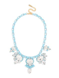 This unusual assemblage of clear crystal stones has a profusion of fringe, dots, and feathering. With disco ball-like glimmer and a graphic box chain, this statement necklace adds plenty of visual interest.