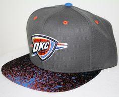 Oklahoma City Thunders Mitchell & Ness NBA Splatter Snapback Hat - http://bignbastore.com/nba-hats/oklahoma-city-thunders-mitchell-ness-nba-splatter-snapback-hat
