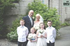 The bride & groom get a photo with all the kids at the wedding. Weddings at The Johnstown Estate, photographed by Couple Photography.