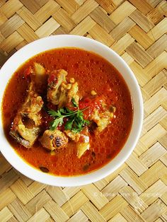 Medley of spicy and tangy flavours....lamb meat with bones cooked in tangy tomato gravy......