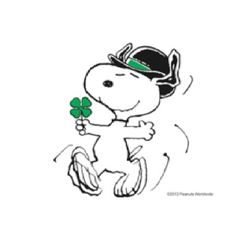 Snoopy dancing a jig with a shamrock