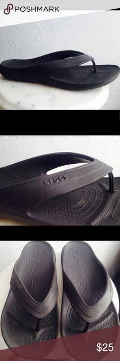 CROCS Black Men's Flip Flop Sandals Shoes In great condition, very light wear ( shown in photos). CROCS are one of the most comfortable and versatile shoes that are also super lightweight for travel!  These are a great find in like new condition! Men's size 12. CROCS Shoes Sandals & Flip-Flops