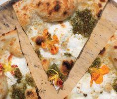 Nasturtium Pizza (little edible flowers and pizza together...yum)        Nasturtium Pizza Recipe  at Epicurious.com