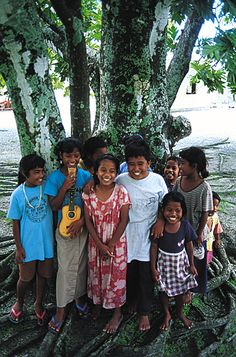 Marshall Island people holding up their crabs. | World wetlands day, Marshall islands