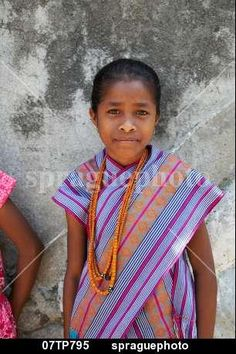 Girl wearing traditional dress including ikat weaves and beads,  Oecussi-Ambeno, East Timor stock image