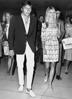Brigitte Bardot and boyfriend Gunter Sachs, German playboy, arrive at Los Angeles Airport, July 13, 1966. They flew to Las Vegas and were married a few hours later.