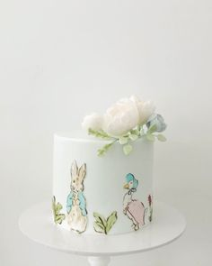 the sweetest little baby shower cake with hand painted detail and delicate sugar flowers! Peter Rabbit Cake, Peter Rabbit Birthday, Peter Rabbit Party, Birthday Bbq, Bunny Birthday, Birthday Ideas, Birthday Cake, Johnson Baby, Bunny Party