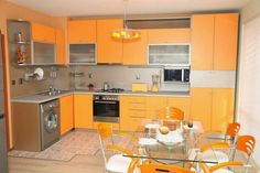 Kitchen:Small Space Kitchen Open Concept Grey Countertops Glass Dining Table Dining Chairs Washer Kitchen Sink And Tap Kitchen Tools Hanger Dimmer Hanging Floating Wall Mounted Kitchen Cabinet Storage Wall Kitchen Color Influences the Performance