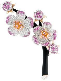 Van Cleef & Arpels. Cérisier d'ébène clip, Palais de la chance collection; white gold, diamonds, pink gold, pink sapphires, ebony