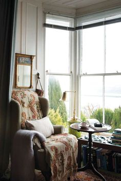 A perfect place to curl up with a book and a cup of tea. Chair from ikea with a blanket and throw pillow!!!