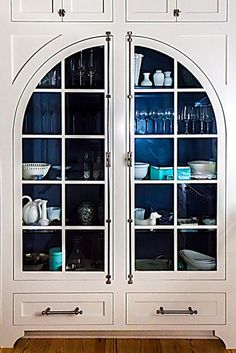 China cabinet.  Love those arched doors.