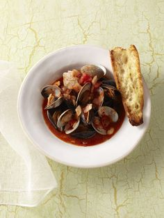 Mussels and Clams with Spicy Tomato Broth Recipe : Food Network Kitchen : Food Network - FoodNetwork.com