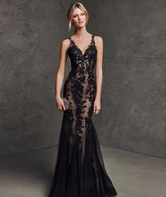 Stunningly sexy mermaid style gown. Gorgeous black lace over a nude shell to give the illusion of something more…or something less. The dress has a deep v-neck top with lace, tank style straps and sex