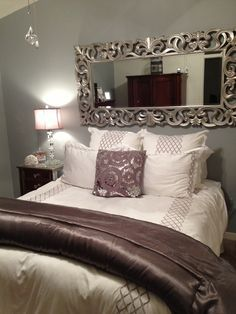 Home Decor - Bedroom Decor   Nice use of the mirror to take away from no headboard bed; grey, silver, plum
