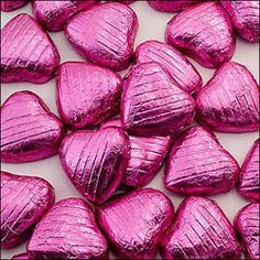Pink foil chocolate hearts £14.00 for a 500g. Fill your wedding favour boxes or organza bags with these pink chocolate hearts for a splash of colour to your tables.
