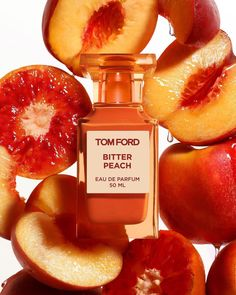 TOM FORD Bitter Peach Eau De Parfum: This fragrance contains notes of intoxicating pêche de vigne and Sicilian blood orange oil that release the slick sweetness of a bitter peach at its luscious peak. It has a sensual heart of rum-infused davana oil, while a surge of patchouli and sandalwood lures the senses to the furthest reaches of inner sensuality and abandon Perfume Tom Ford, Perfume Scents, Perfume Oils, Patchouli Oil, Tom Ford Beauty, Orange Oil, Blood Orange, Smell Good, Body Spray