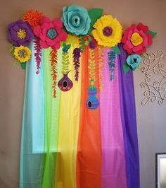 DIY trolls birthday party. Foam paper flowers and six dollar store table cloths.