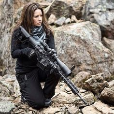 """This was originally captioned """"girl with gun"""" but Melinda Sonju is a founder of Falkor Arms and deadly with the Petra .300 Win Mag she's holding."""
