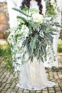 Organic, Whimsical, cascading green and white, rustic wedidng bouquet with protea, ferns, hydrangea, eucalyptus and more! Pic:  Jack And Jane