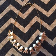 J. Crew statement necklace Gold statement necklace with white pink and gray accents. It's in great condition! J. Crew Jewelry Necklaces