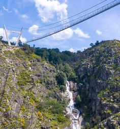 Portugal: The nail-biting new see-through '516 Arouca' footbridge that hangs 575ft above a river - Daily Mail 12-10-2020 | Would YOU dare cross it? The nail-biting new see-through footbridge in Portugal that hangs 575ft above a river. The bridge's walkway is 516 metres (1,692ft) long and made from a see-through 'open grid' metal mesh. Its designers say the experience of walking along it 'mimics the feeling of walking through the air'