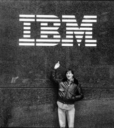 """""""This rare photograph of Steve Jobs demonstrates the Apple co-founder's infamous rebellious spirit as he """"flips the bird"""" outside an IBM building in New York City. It was taken in 1983..."""""""