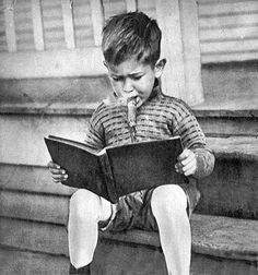 5yrs old, smoking a cigar and reading a book. I CANNOT BELIEVE he's 5 and reading a book.