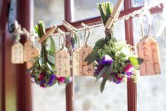 Inverted bouquets on clothes pin line as a place card holder {Design: TableArt}
