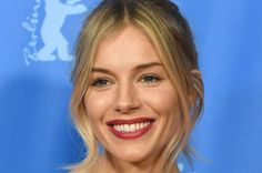 """Sienna Miller dismissed reports of a romance with Brad Pitt while attending a New York screening of """"The Lost City of Z."""""""