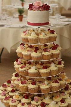 Cupcake Tower instead of wedding cake! (Lindsey note: I like the cupcakes with little flowers on them, but instead they need to be red, orange, and gray. The top cake will be different) Vintage Wedding Cupcakes, Cupcake Tower Wedding, Wedding Cakes With Cupcakes, Wedding Cake Designs, Cupcake Towers, Floral Cupcakes, Wedding Ideas, Cupcake Stands, Vanilla Cupcakes