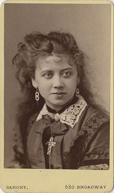 Rosina Vokes, a popular actress who lived from 1854–94. Click on the image to learn more about her.  You have to scroll down a bit. Napoleon Sarony, who took the picture, was a portrait photographer most known for his portraits of the stars of late-19th-century American theater. His pictures of people like Mark Twain and Oscar Wilde are in museums around the world. She is striking looking.