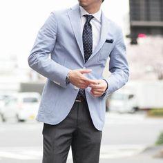 Light blue sport coat white buttons, silk polka dot tie