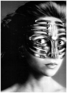 Penelope Tree wearing a mask of Emanuel Ungaro. Photo by Richard Avedon(1968)