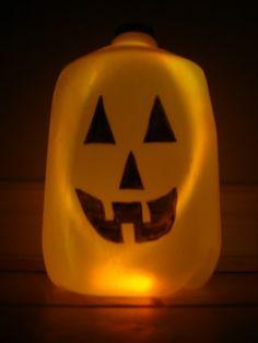 Super easy jack o lantern...empty plastic jug/face drawn on with sharpie/orange glow sticks added.