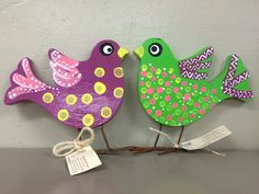 Colorful and adorable bird décor hand painted by adults with intellectual and developmental disabilities.
