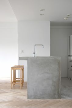 Japanese simplicity - beautiful concrete island... We could add colour in our own way with bowls etc..