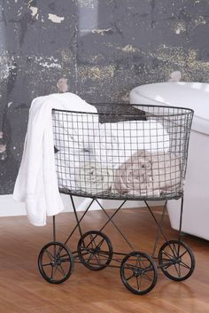 this is so smart! maybe i can find an old trolley and do the same [vintage laundry basket reproduction via boston interiors]