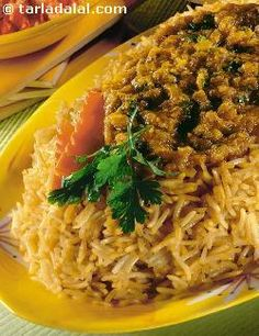 """Serve this traditional Parsi dish with fried """"papad"""" sweet mango chutney, curds and chopped onions and tomatoes."""