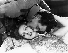 """Greta Garbo and John Gilbert in """"Flesh and the Devil"""" (1927).  The two actually shared an off-screen love affair that was so passionate movie goers were unprepared for the  unbridled passion they would actually see when the movie hit theaters in January of 1927."""