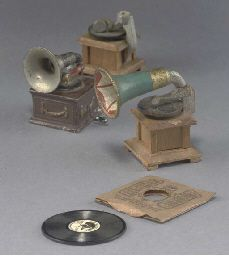 His Master's Voice Record made for Queen Mary's dolls' house playing God Save the King, in original sleeve --1½in. (4cm.) square; an Ernst Plank gramophone (horn detached); and two wooden gramophones (one missing horn)