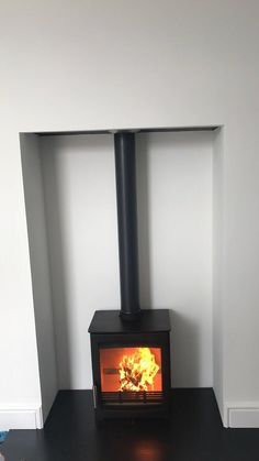 A very near finish to this install of a Parkray Aspect 4 with granite hearth. Granite Hearth, Family Room, It Is Finished, Home Appliances, Wood, House Appliances, Madeira, Woodwind Instrument, Family Rooms