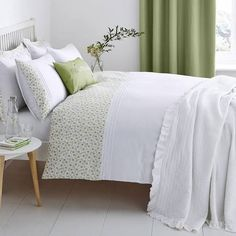 green and white bed linen